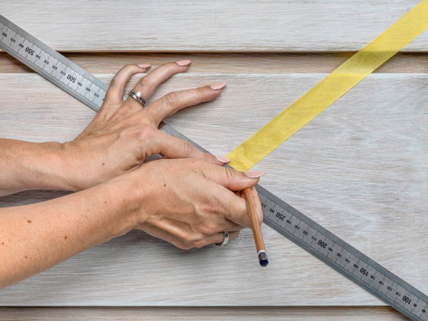 Draw out your design on a piece of paper, anything goes, the bolder the better!Measure out and tape your design onto the furniture using masking tape. Sofie kept her drawers in the unit as she found this easier.