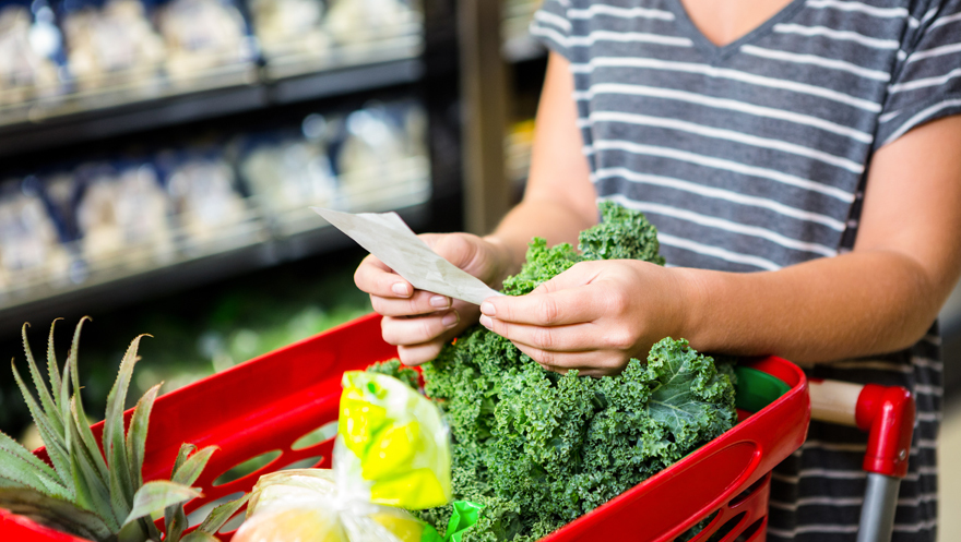 Lady reading a shopping list at a supermarket Pic: Rex/Shutterstock