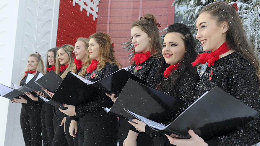 A choir outside the Ideal Home Show