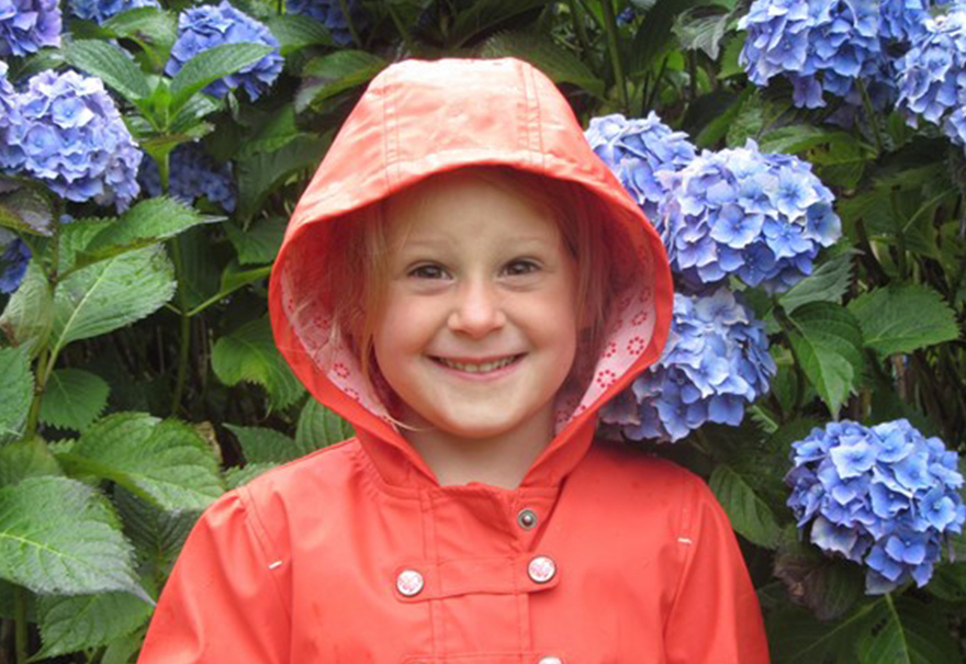 Lyla Brown, aged 5, in a red raincoat