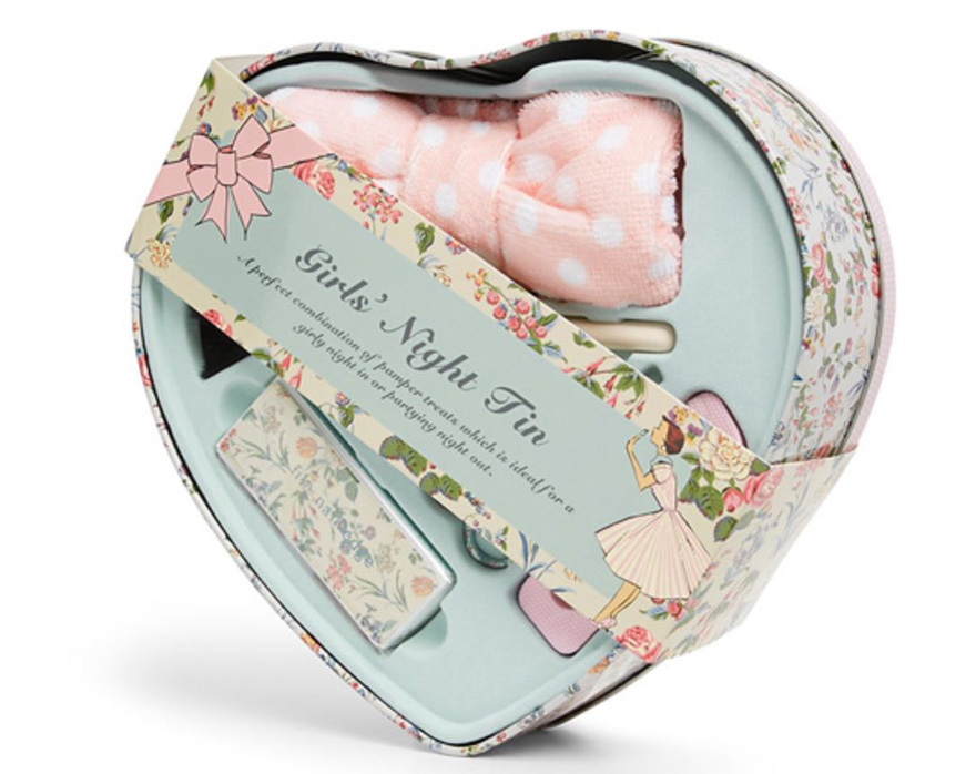 A heart-shaped tin filled with beauty products