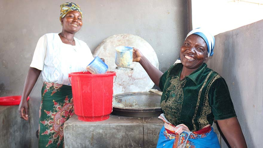 Esme (right) prepares to serve the likuni phala