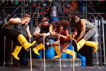 The STOMP stars in action wearing yellow wellies!