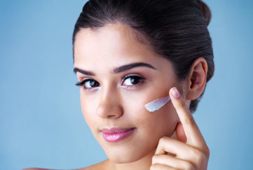 Studio portrait of a beautiful young woman applying face cream Pic: Istockphoto