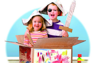 boy and girl playing in cardboard box