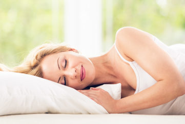 Woman sleeping in her bed Pic: Istockphoto