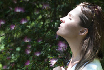 Woman with sunglasses on heat breathing deeply