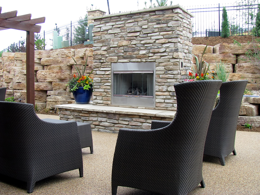 An outdoor fireplace on the patio for entertaining and relaxation