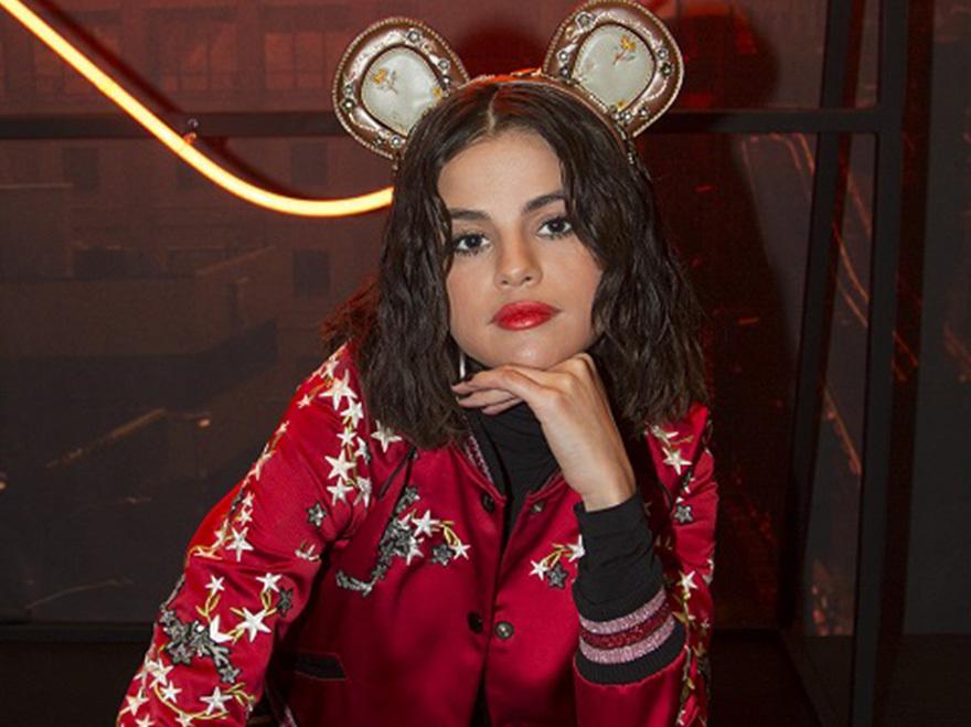Selena Gomez wears the ears she designed with Coach