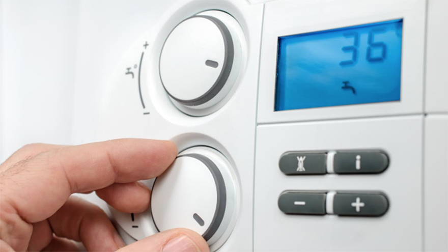 Hand adjusting central heating controls