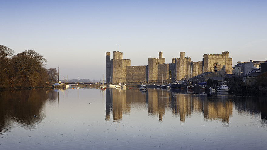 General view from the south east Caernarfon Castle Cadw Sites World Heritage Sites SAMN: CN079 NGR: SH477626 Gwynedd North Castles Medieval Defence Historic Sites