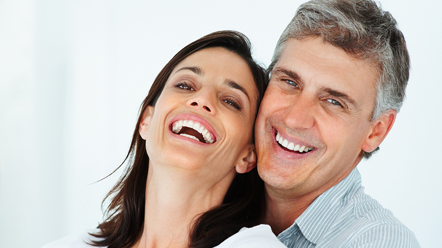 Close-up of a mature couple laughing