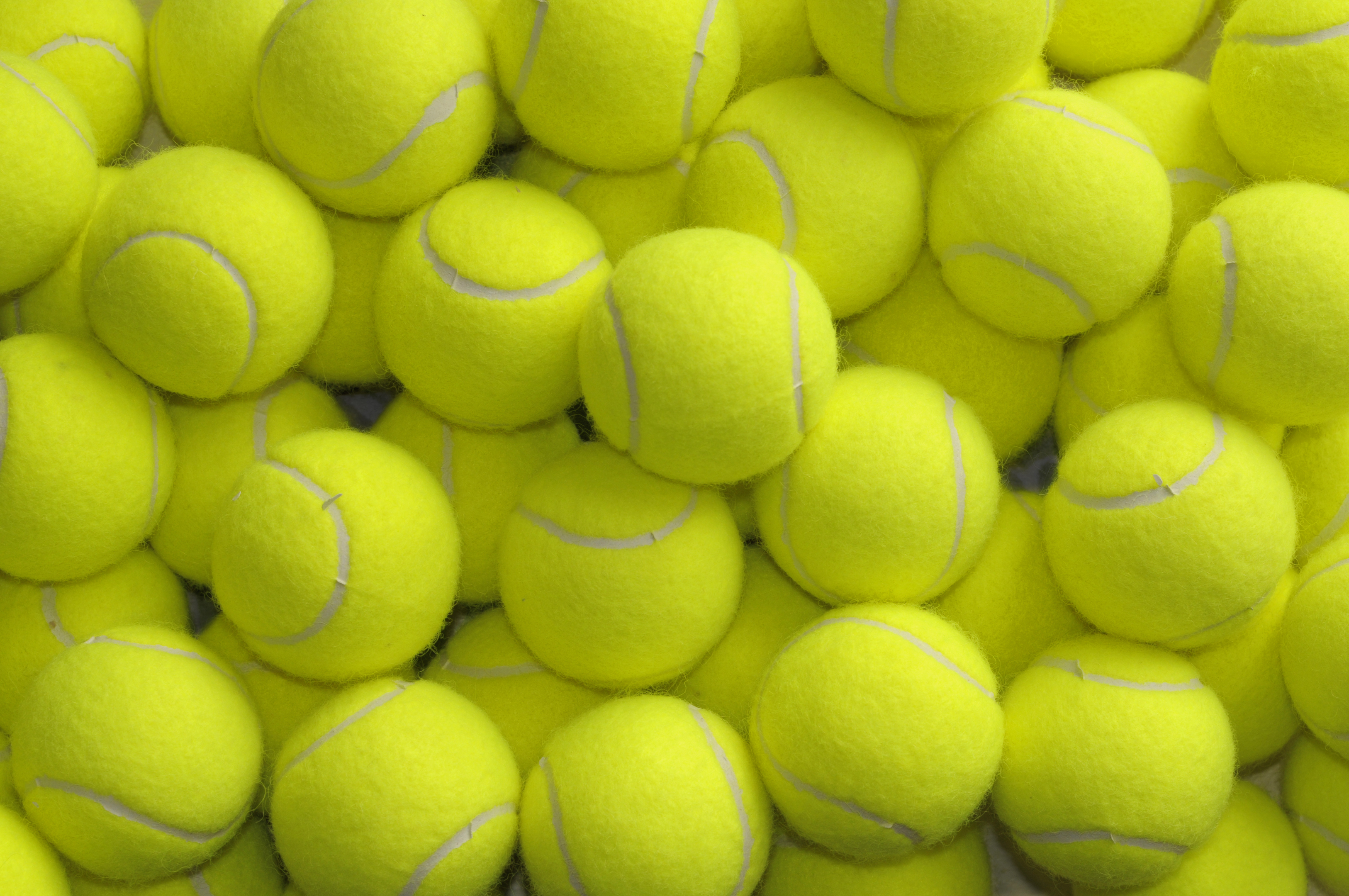 Pile of loose tennis balls