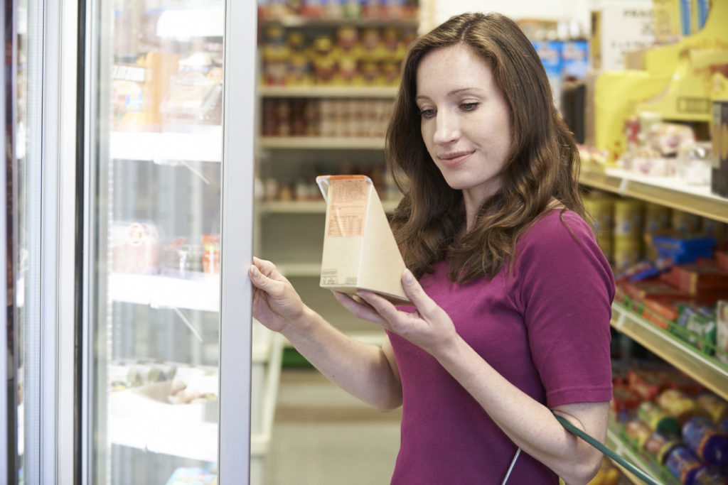 Woman Buying Sandwich From Supermarket