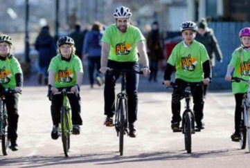 Mark and children cycling