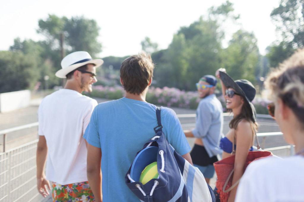 People leaving tennis court