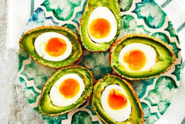 Avocado scotch eggs on a plate