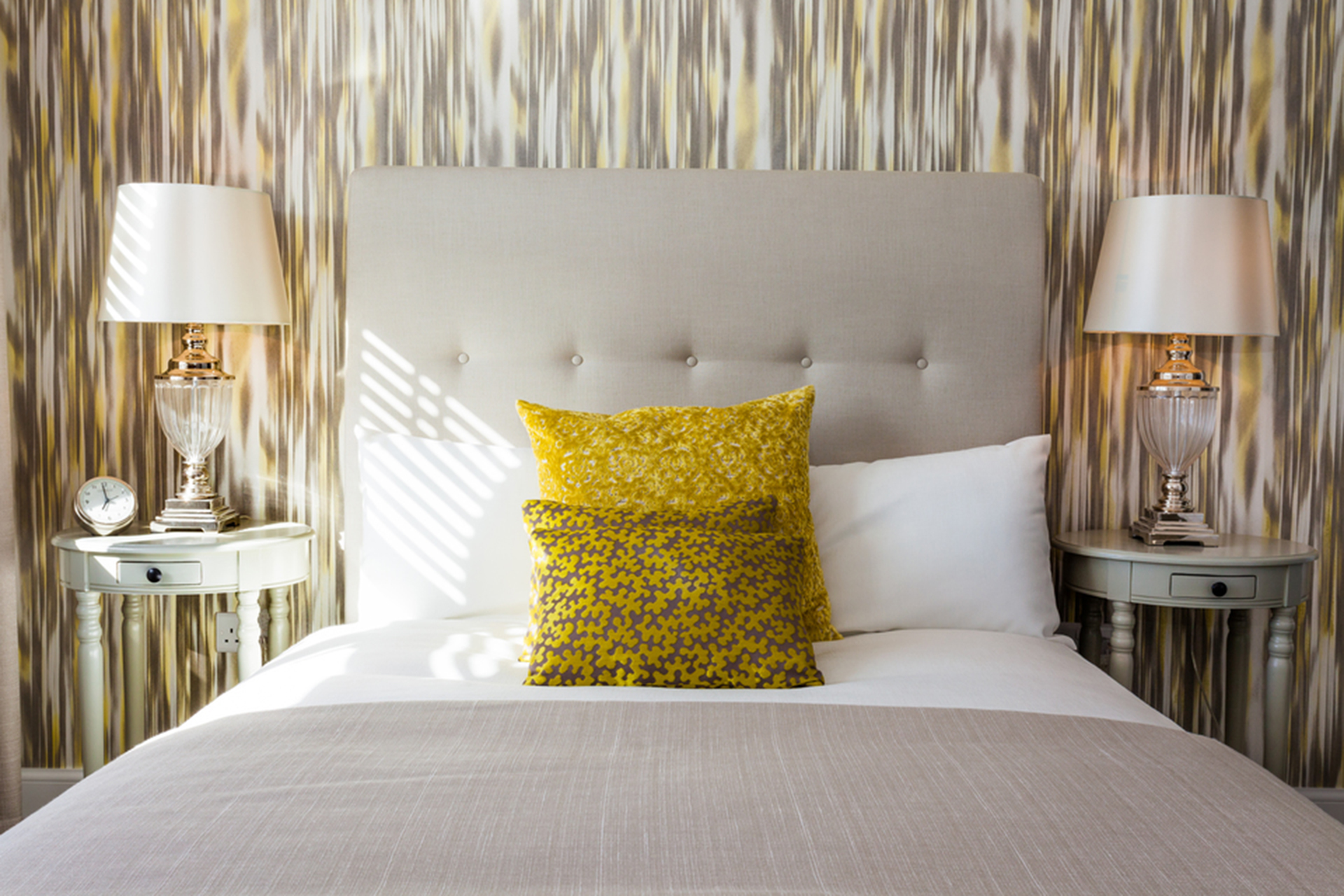 Bed decorated with yellow cushions
