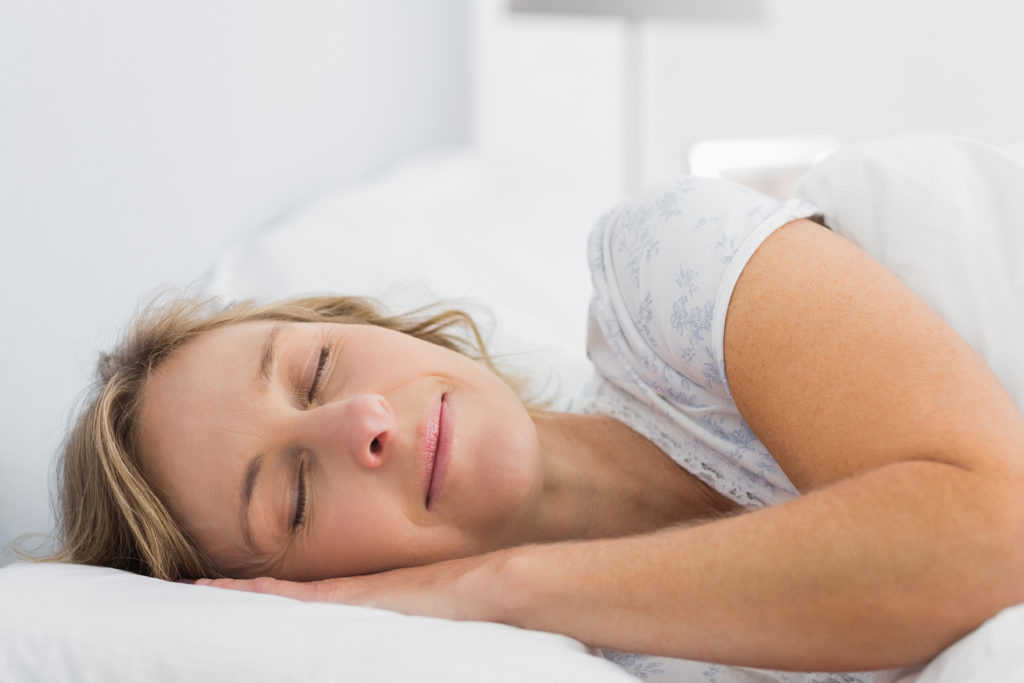 Woman sleeping on her side peacefully