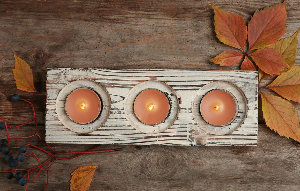Candles and autumn leaves