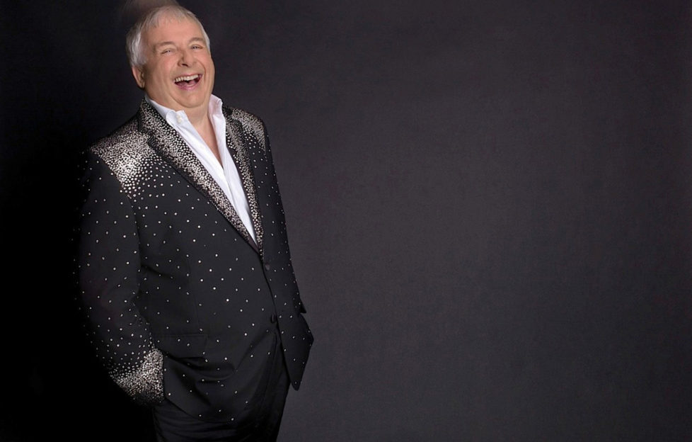 Christopher Biggins in a black and silver suit