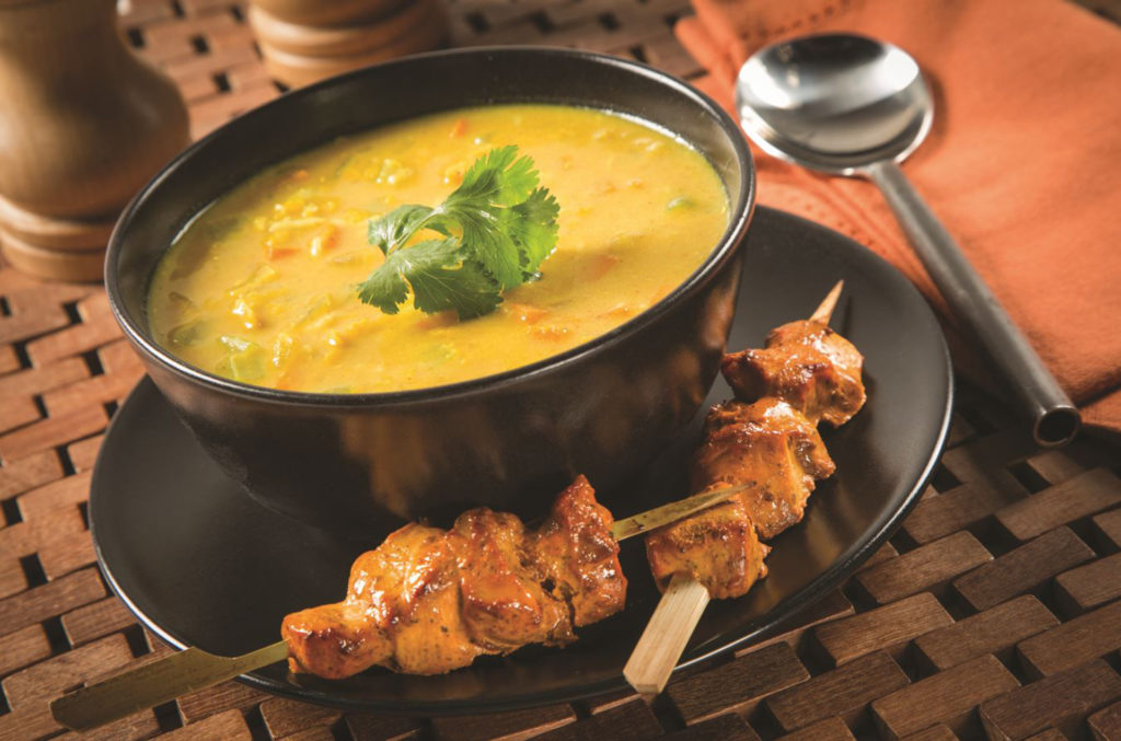 Broth with chicken skewers