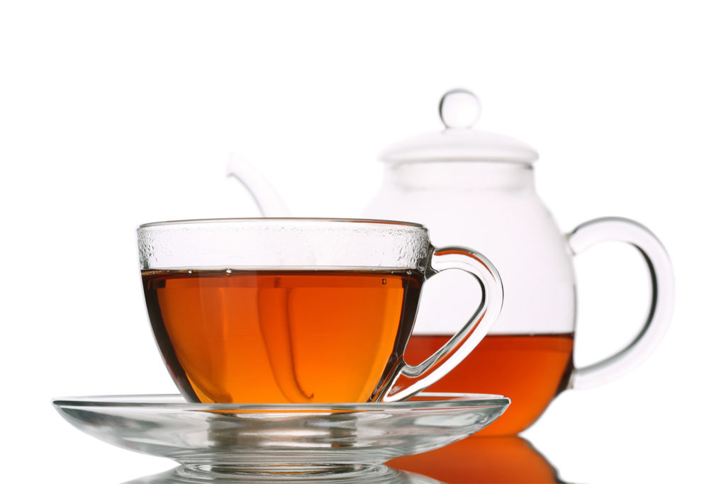 Full Tea Cup and Half Glass Pot
