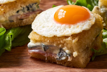 Close up of mini croque madame with fried quail's egg on top