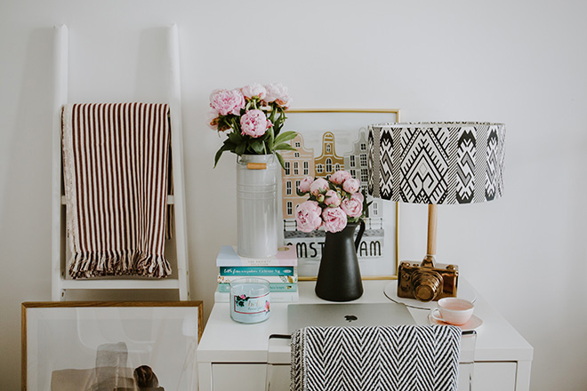Desk and table with accessories Photo by Alisa Anton on Unsplash