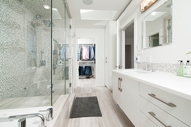 A bathroom in pale tones Photo by Jose Soriano on Unsplash