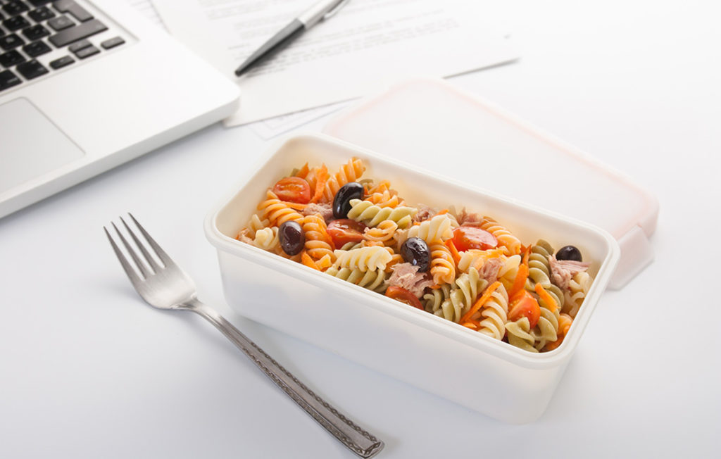 Eating a pasta salad with vegetables and tuna in the office Pic: Istockphoto