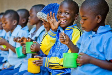 Children enjoying food from the Mary's Meals school feeding campaign Pic: Chris Watt