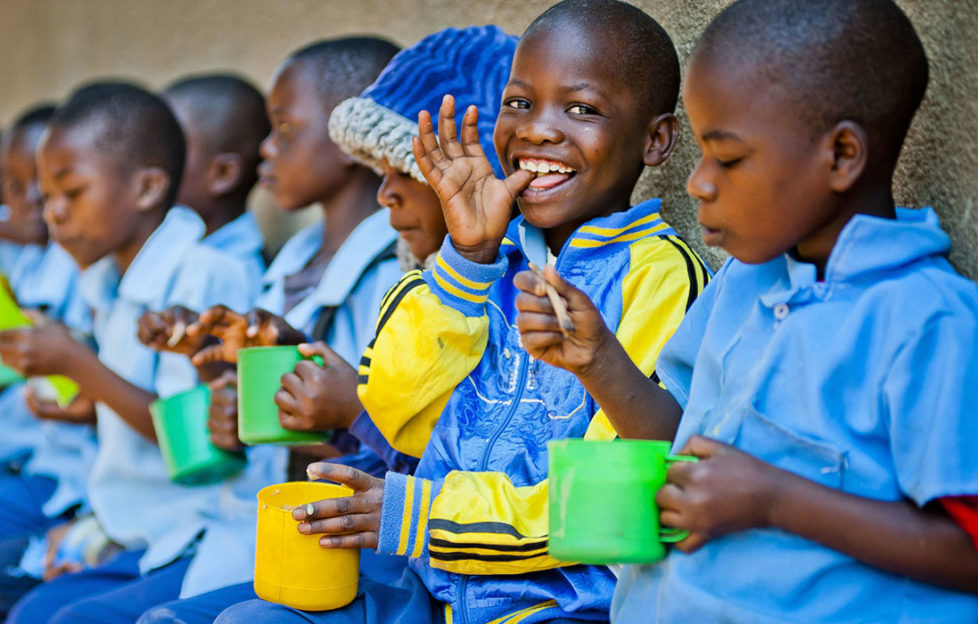 Children enjoying food from the Mary's Meals school feeding campaign Pic: Chris Watt