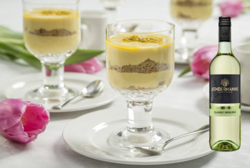 Mango cheesecake in a dessert glass with Classic Riesling