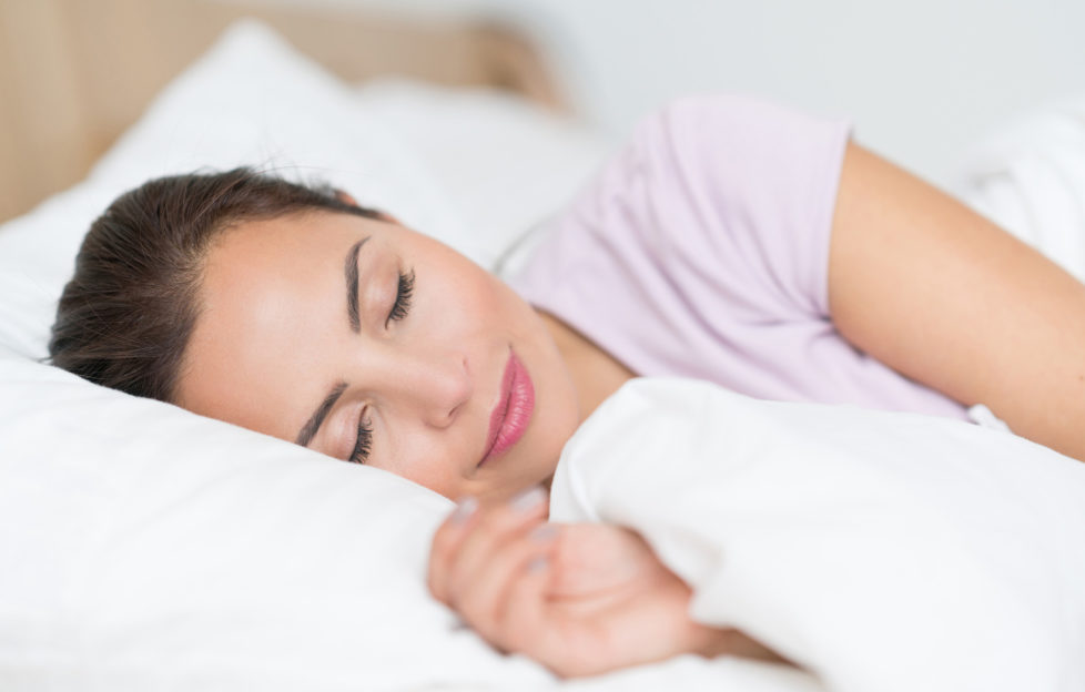Portrait of a beautiful woman sleeping in bed and looking very peaceful