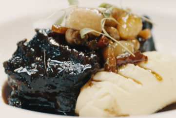 Braised ox cheek with dark caramelised stock, creamed potato and vegetables