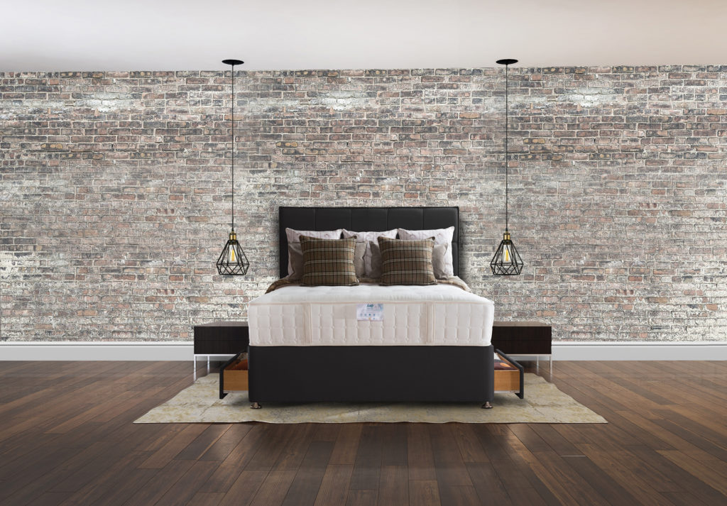Bedroom with concrete brick wall and wooden floor