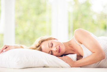 Woman sleeping in her bed peacefully Pic: Istockphoto