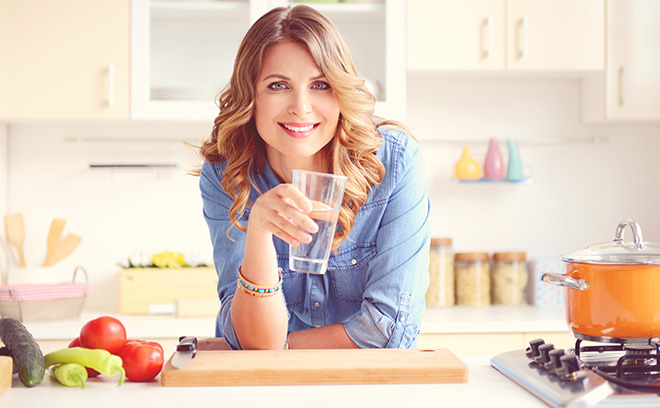 Lady with healthy food and a glass of water Pic: Isockphoto