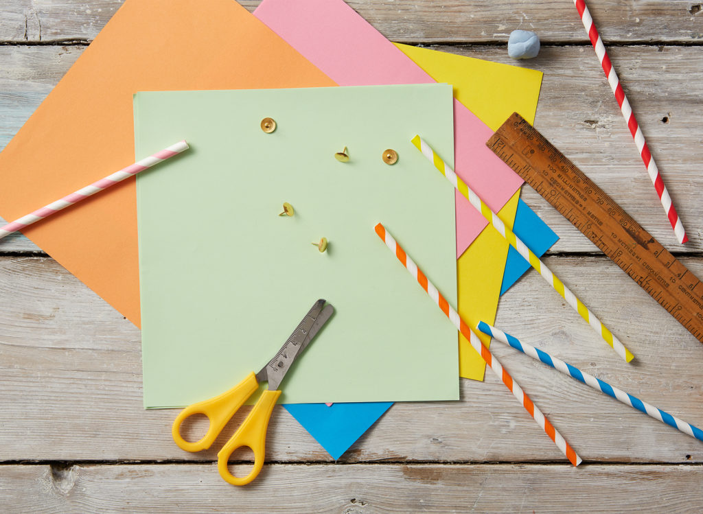 Material to make pinwheels - coloured paper squares, paper straws, drawing pins, ruler, scissors