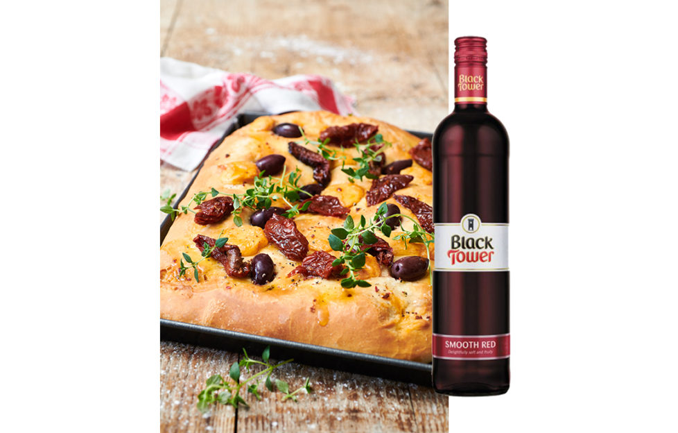 Focaccia bread and a bottle of Black Tower Smooth Red wine