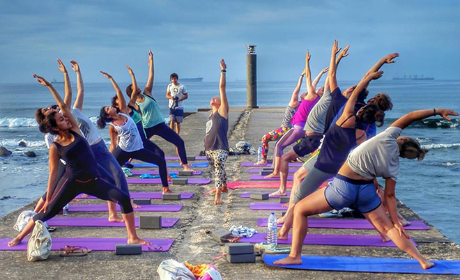 Yoga on a pier at the sea