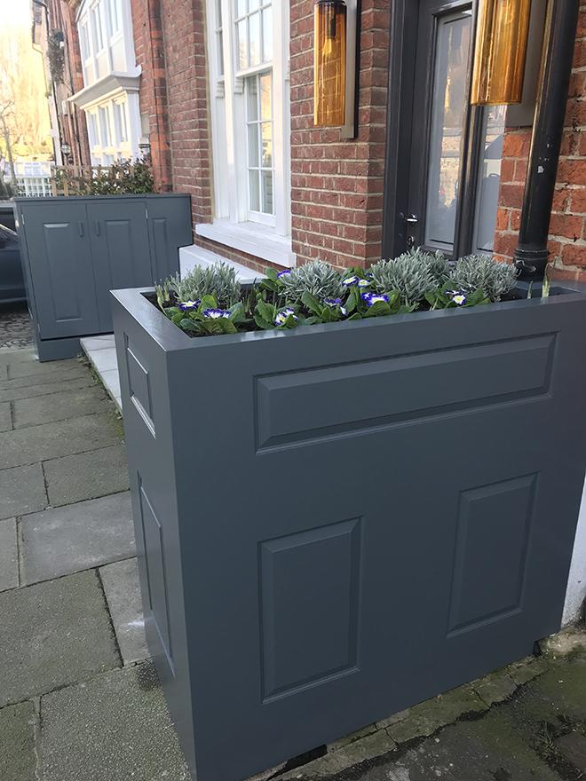 Hide bins away under these modern planters