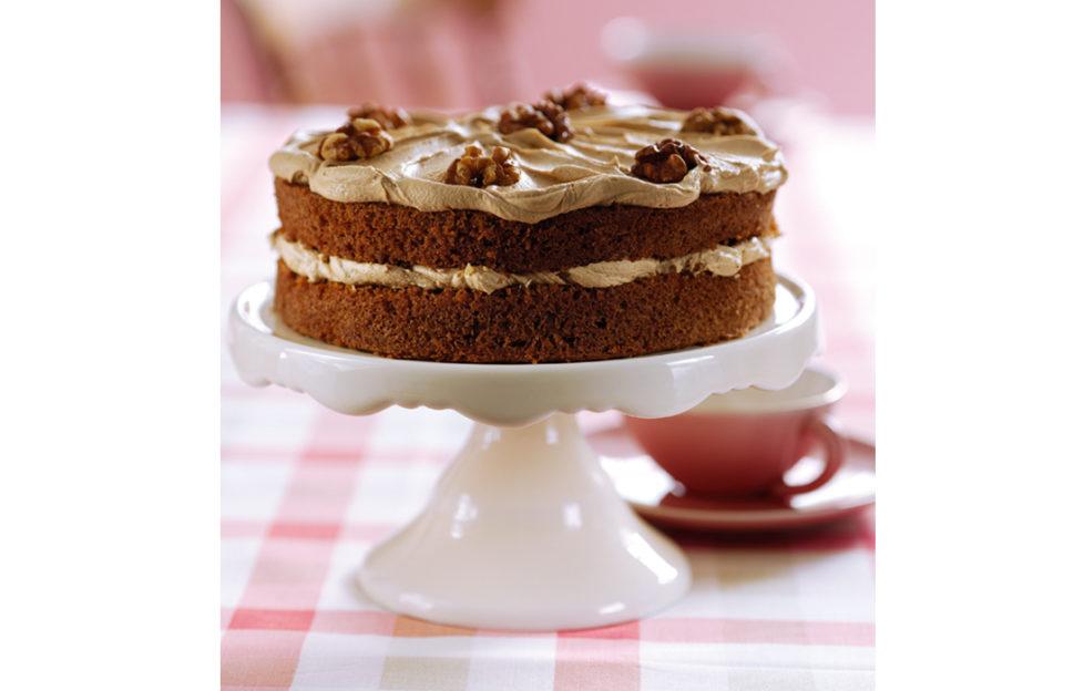 Coffee and walnut cake on a cake stand