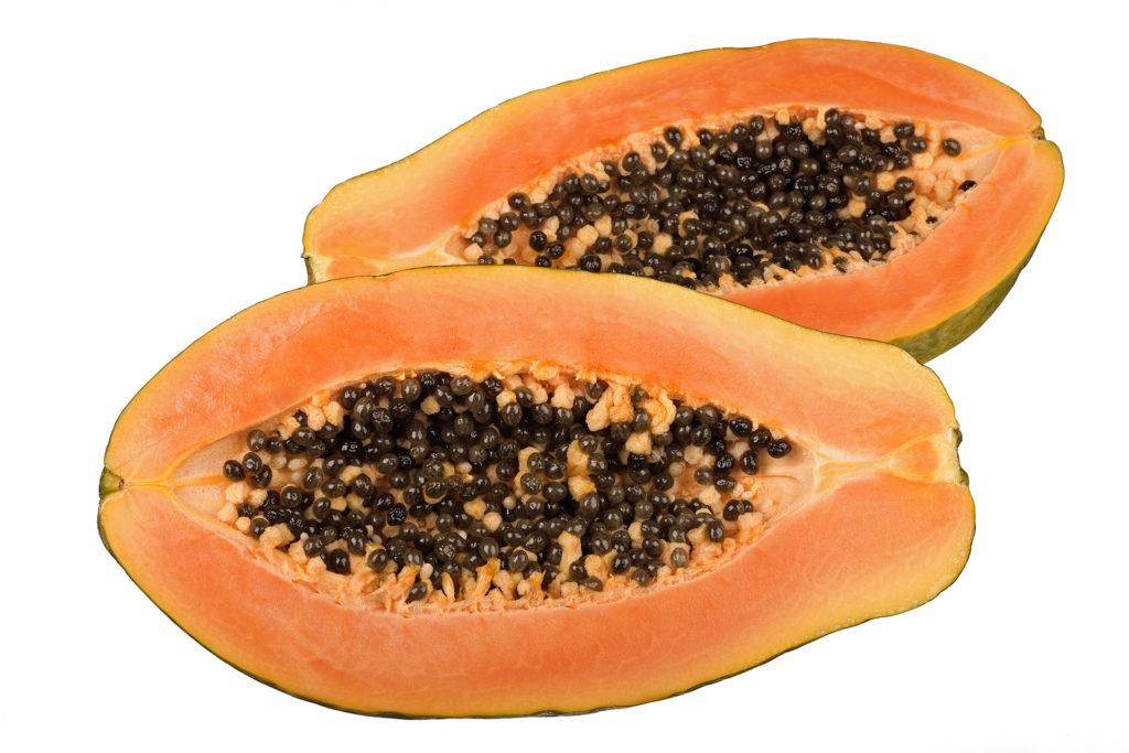 papaya halves isolated on white background