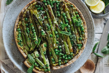 Asparagus, pea and mint tart, wholemeal nutty pastry crust, slices of lemon on the side, one slice cut
