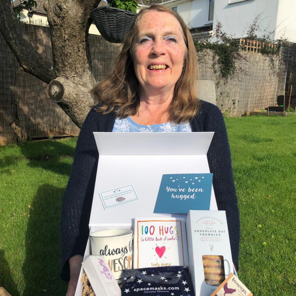 Brain tumour survivor Jane with one of the Box Of Hugs gift boxes