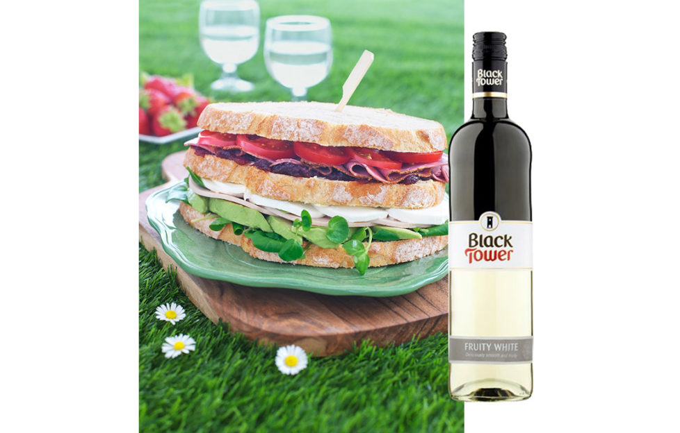 Tricoloured sandwich and Black Tower Fruity White Wine