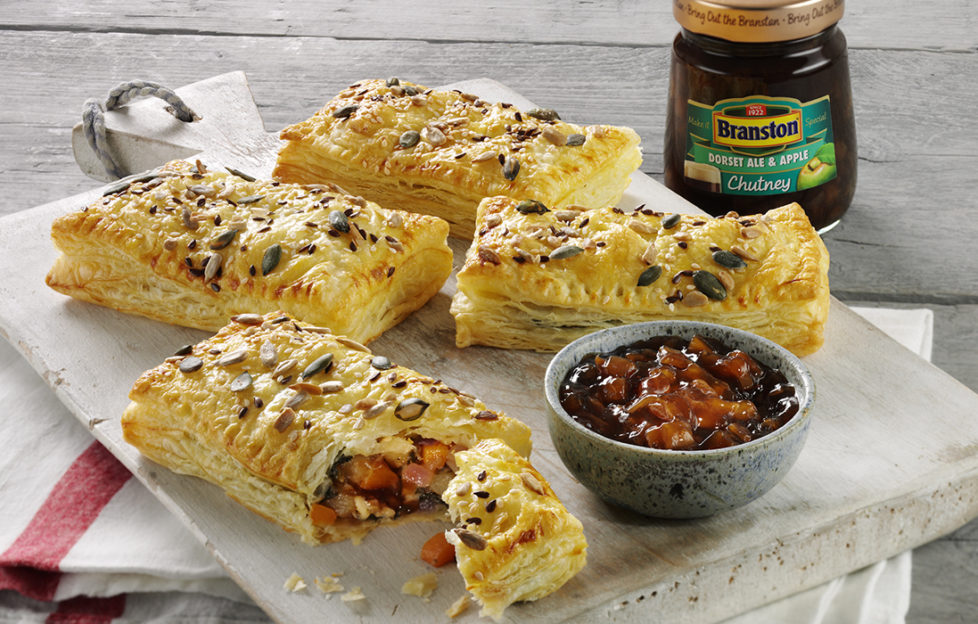Cheese and pickle pastry puffs on a plate with dish and jar of Branston Dorset pickle