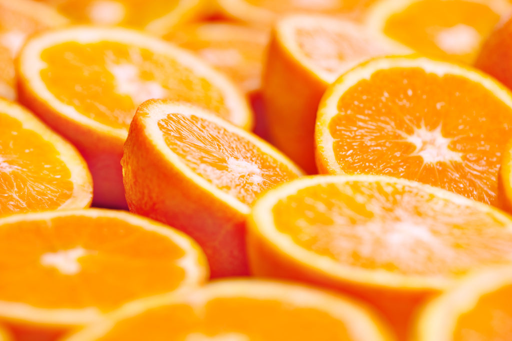 Selection of oranges cut in half
